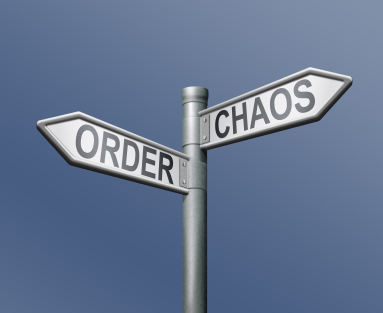 directional signs: one pointing to order and one to chaos