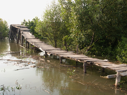 very fragile, collapsing wooden bridge
