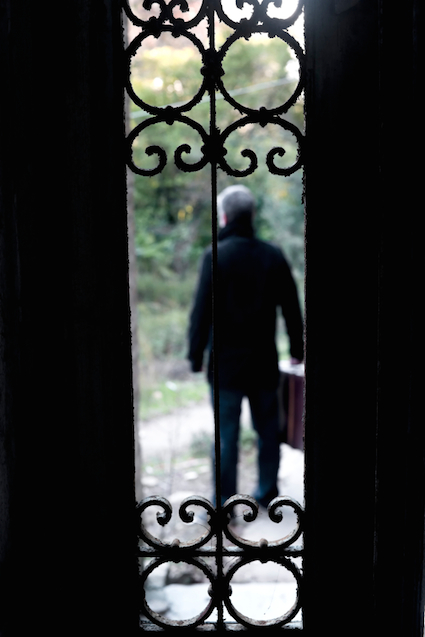 blurred man standing outside the door